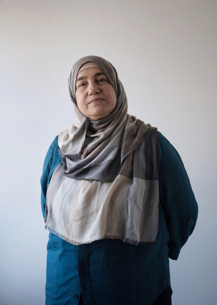 Bushra Faris, 56, interpreter (OBGYN surgeon in her native country,) Columbia, MO, originally from Iraq. My name is Bushra Faris, I grew up in Baghdad, Iraq. I am fifty-five years old and the mother of three sons and a beautiful daughter. I graduated from medical school in Iraq in 1986 and I worked in different departments in Iraq for thirteen years. I am originally from the north of Iraq, Kurdistan, and the spoken language is Kurdish, which is completely different from Arabic. However, I am more fluent in Arabic than Kurdish because I was born and lived in Baghdad. I left my home country in 1999 to continue my study for the Arab Board of Gynecology and Obstetrics in Amman, Jordan. I spent ten years in Jordan, then I traveled to Columbia, MO, in 2008 as a refugee because of the war and living conditions in Iraq. I have been working as a part time medical interpreter and I am happy with this position because it is in the same work environment I used to work in before coming to the US. I didn't try the tests for USMLE, which is for being a certified physician at USA because I needed time and money for that, which my kids need them more than me. Hopefully, we can live in peace and have a better life in US to Let us make up for the years we have suffered.