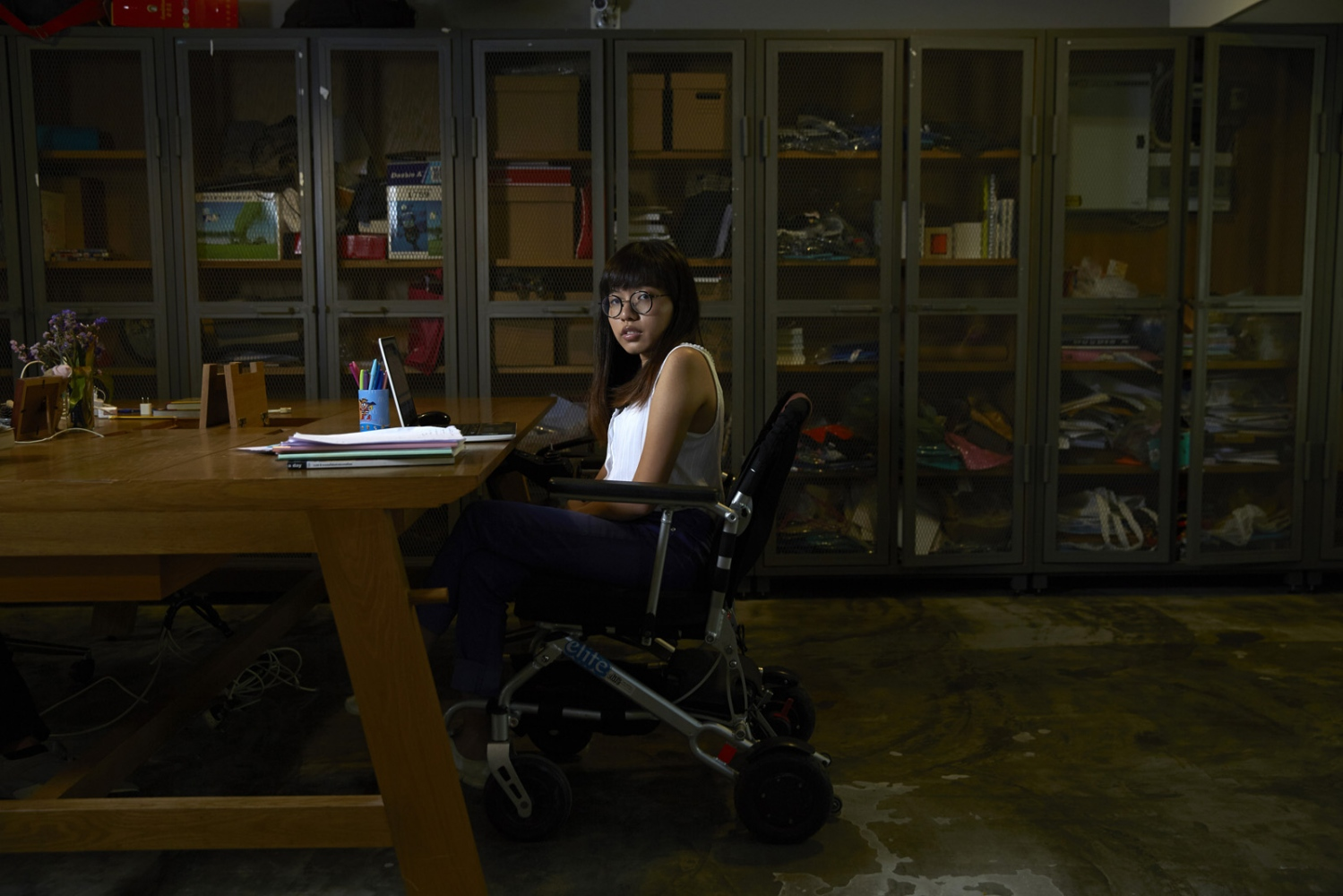 Nalutporn Krairiksh, a Thai journalist in the newsroom of Pratchatai News Agency. She has been physically disabled since she was born having to use a wheelchair and regularly reports on news the rights and issues of disabled members of Thai society.  Bangkok, Thailand