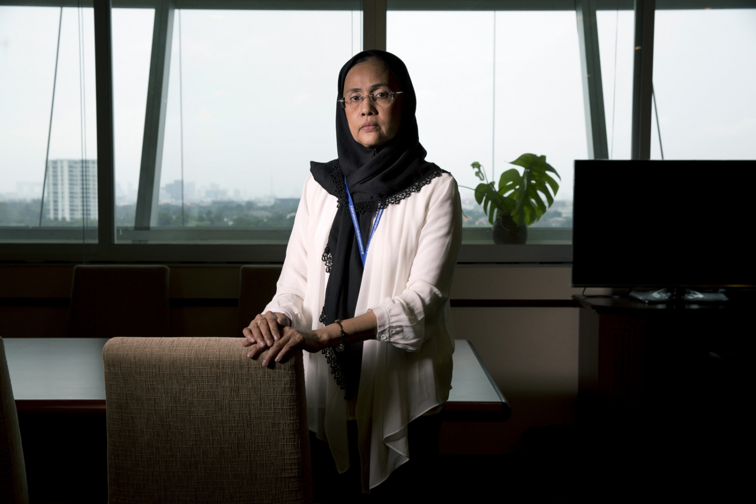 Angkhana Neelapaijit, Commissioner of Thailand's Human Rights Commission, stands in her office in the sprawling Government complex at Chaeng Wattana in Bangkok. Before holding this position she fought her own personal battle to bring justice to her husband, Somchai Neelapaijit, who was abducted in Bangkok and never seen again.  Bangkok, Thailand