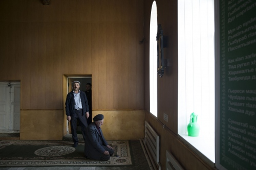 Muslim men from the village of Theletl take Friday prayer in the local village Mosque.  Dagestan, Russia