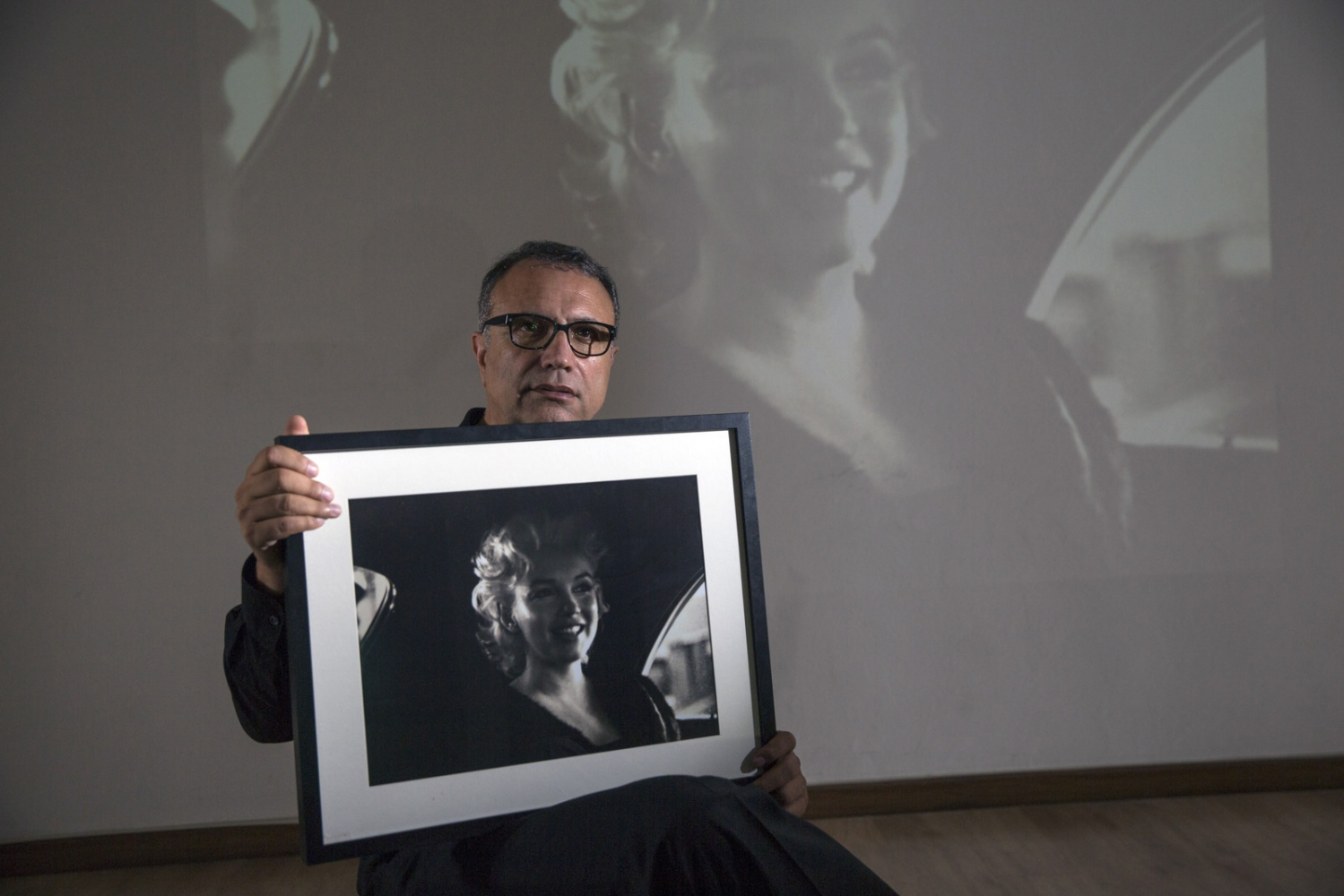 Hossein Farmani sits in his Bangkok photography gallery holding a beloved photograph of Marilyn Monroe which he owns the worlds largest collection.  He is also a gallery owner, exhibition curator, philanthropist and founder and president of the Lucie Awards in New York, International Design Awards, Px3, Paris Photo Prize and LICC, London Creative Awards, Focus on AIDS and the Farmani Gallery.  Born in Tehran, Iran, he emigrated to Los Angeles in 1975 where he studied at the at Hollywood Academy in Hollywood, California before starting his own photography studio which diverged in to many other projects.  Bangkok, Thailand