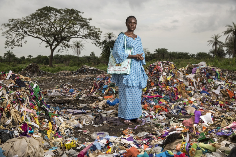 Isatou Ceesay stands at a waste dump in the town of Birkama. Mrs Ceesay founded the Women's Initiative Gambia in 1997. The organisation works with communities across the tiny west African state to address not only the environmental impact of unregulated waste disposal, particularly plastic, but also the empowerment of women in the make dominated society. Over one hundred women are now involved in Isatou's project.  The Gambia
