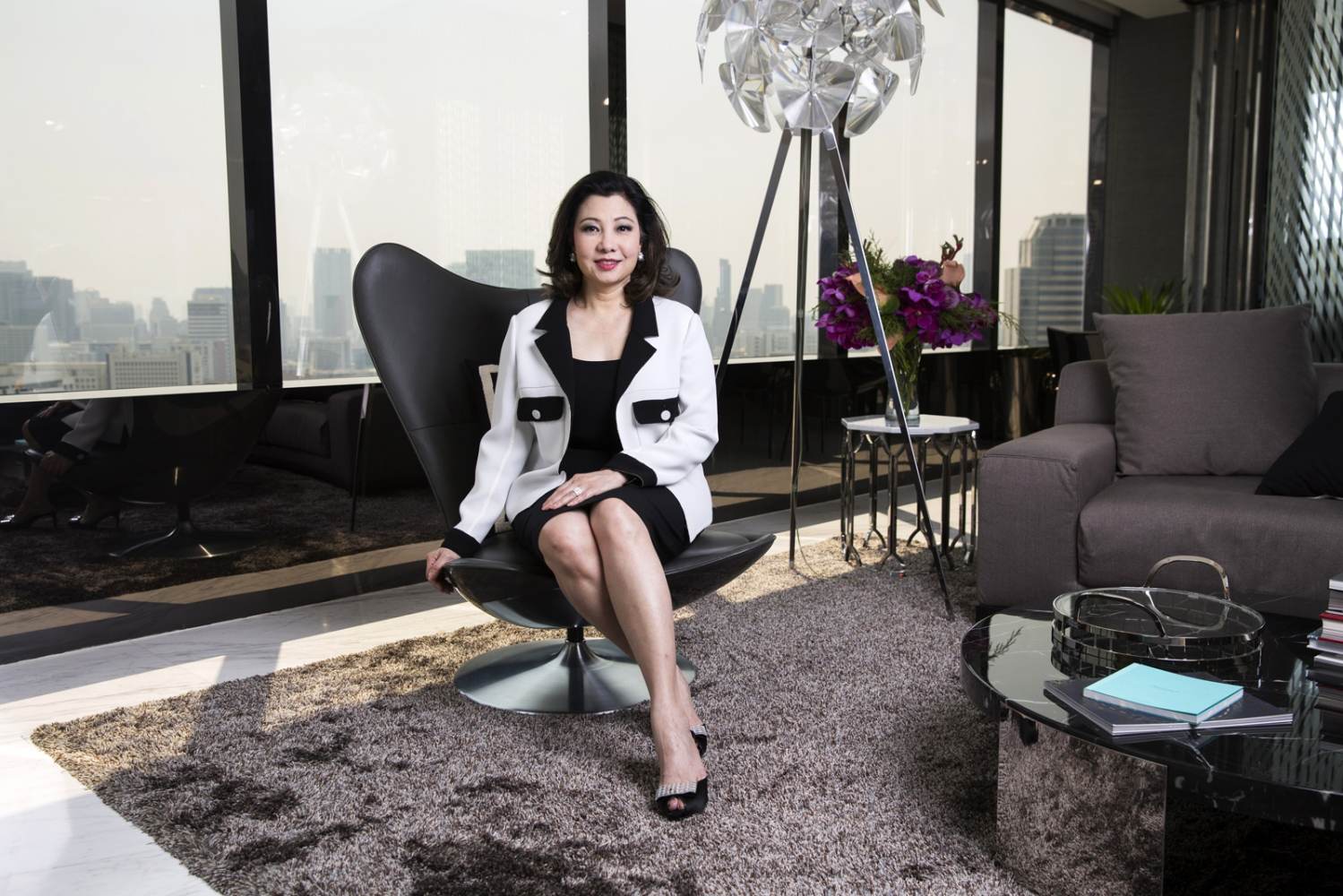 Chadatip Chutrakul, 55, inside the sales office of ICONSIAM in Bangkok. She is the CEO of Siam Piwat, a Thai retail and property development company. Born in 1961, Chadatip attended Chulalongkorn University in Bangkok, graduating in 1982 with a B.A. in banking and finance. She spent several years with the British insurance firms of Sedgwick Offshore Resources and Willis Faber & Dumas, before coming back to Thailand, managing energy insurance services for domestic firm Dhipaya Insurance and has been with Siam Piwat since 1986.  Bangkok, Thailand