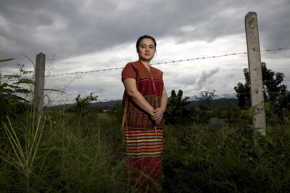 Naw K'nyaw Paw of the Karen Women's Organization in the fenced compound of their Thai headquarters in Mae Hong Son Province. The organisation has 60,000 members and works to fight for the rights of Karen women and children in Myanmar and Thailand.  Mae Hong Son, Thailand