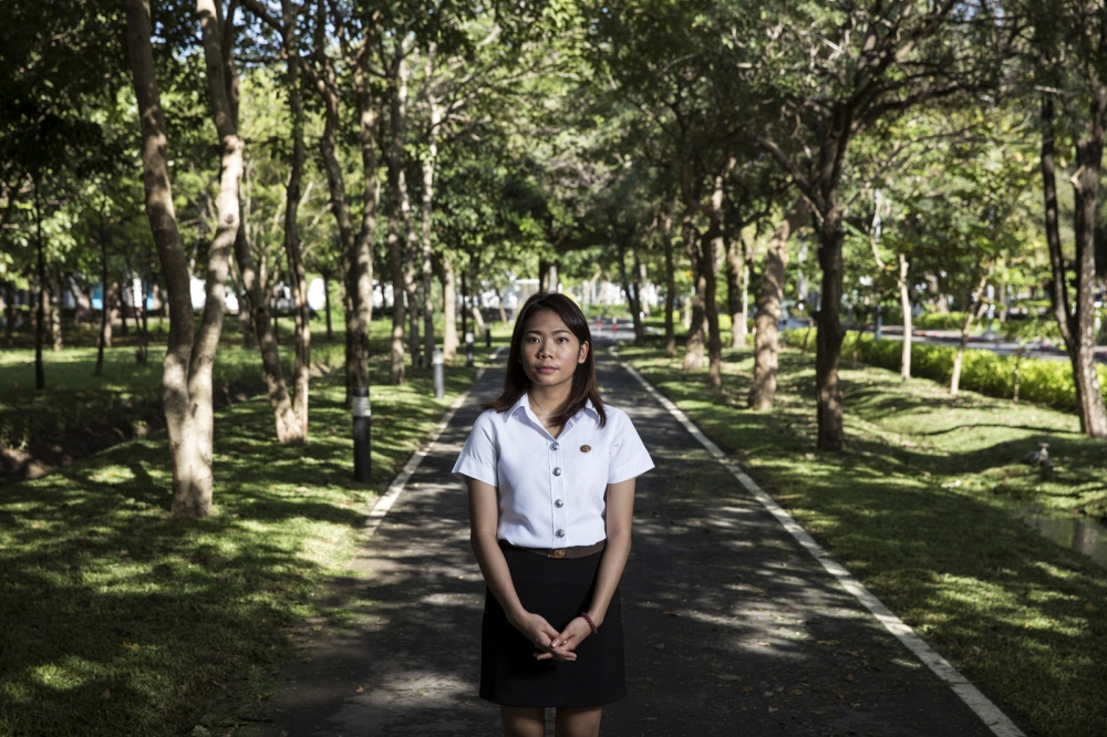 Thararat Panya stands in the grounds of Thammasat University where she is in her fourth year of a law degree. She was the victim of sexual assault by a fellow male student and bravely reported to the University and now speaks openly about her experience.  Bangkok, Thailand