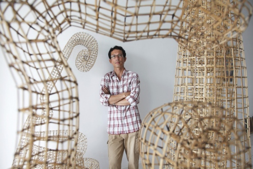 Cambodian artist Sopheap Pich at his studio in Phnom Penh. He uses rattan and bambo to create sculptures representing various aspects of Khmer life. Sopheap grew up in Massachusetts, USA, before returning to Phnom Penh several years ago to continue his artist career. He is now one of the most successful Cambodian artists of his generation having been exhibited in solo shows in New York, Bangkok, Hong Kong, Singapore and Dubai.  Cambodia
