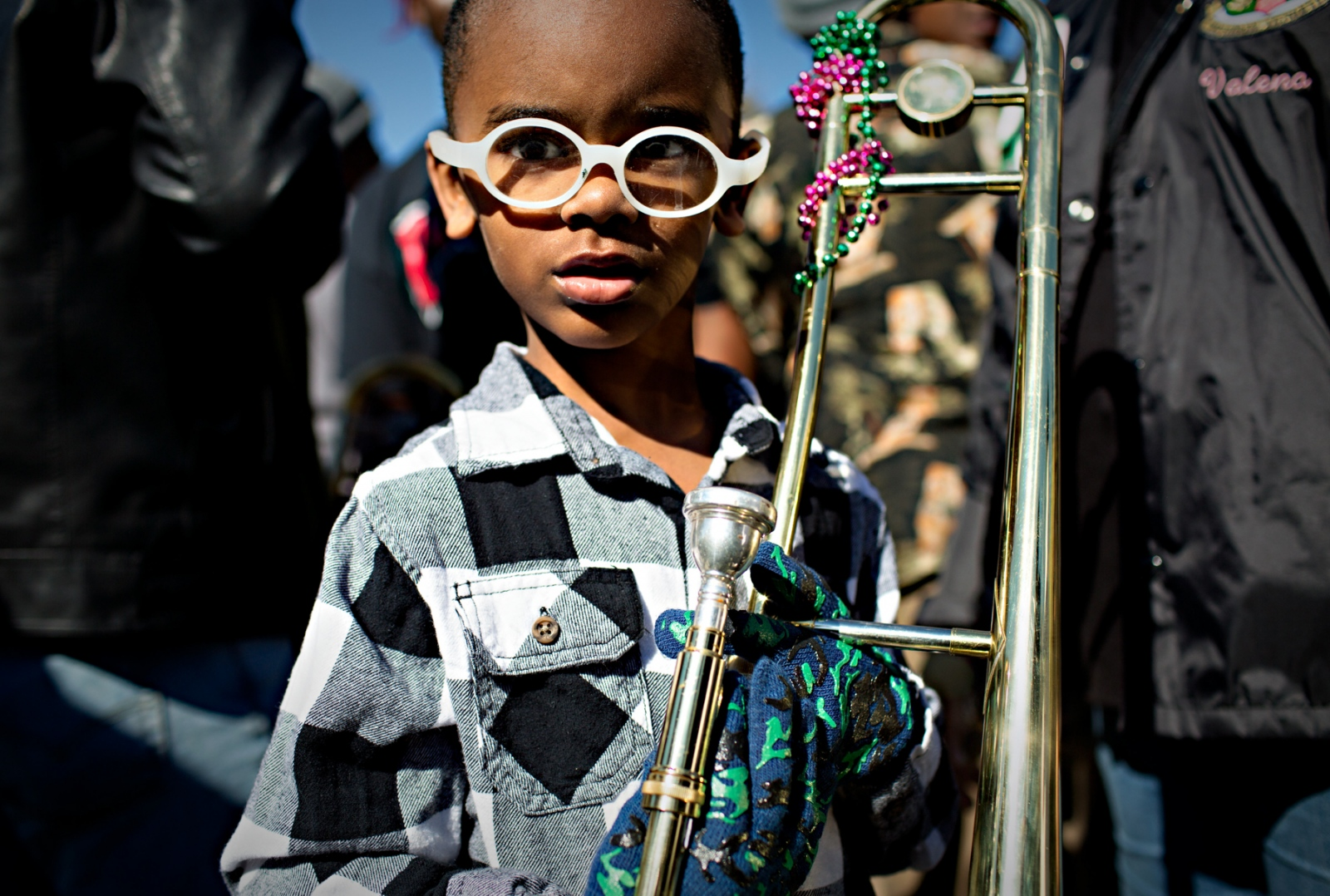 Five years old Alvin Coco has played the trombone since he was two and this Sunday he played with the main band leading the parade.