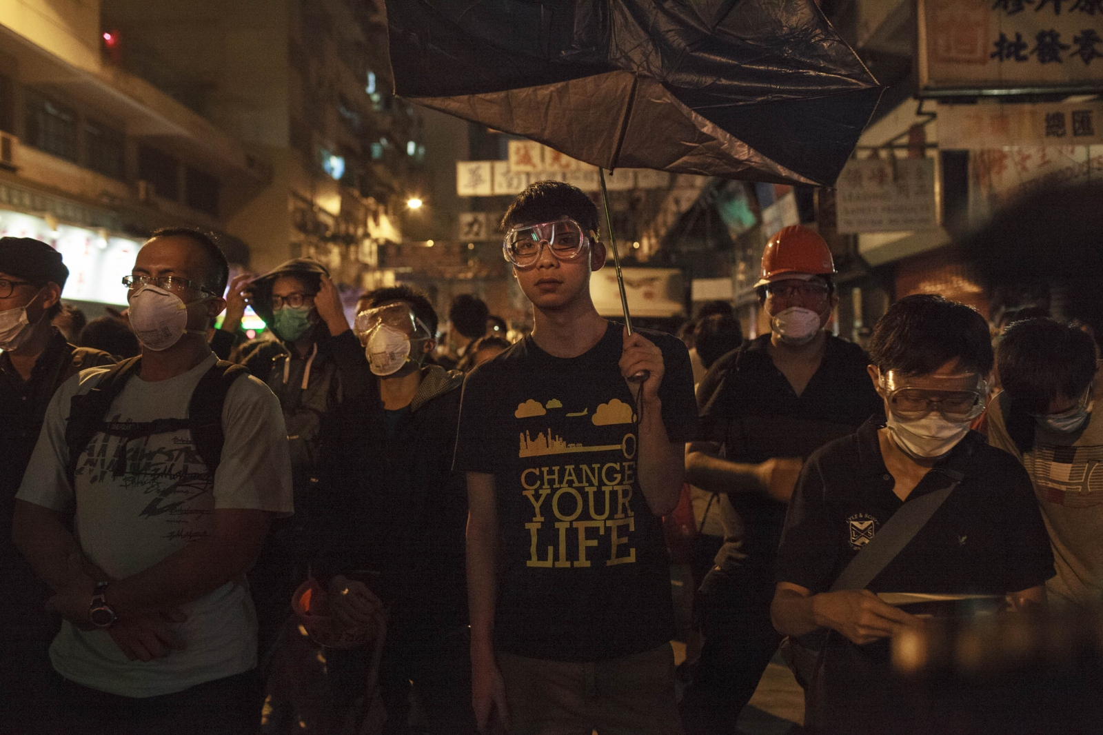 A protester holds an inverted umbrella during scuffles with the police in the Mong Kok district of Hong Kong, on November 25, 2014, the night before the Mong Kok protest site was cleared by the authorities. Pro-democracy demonstrators blocked major thoroughfares and roads of the city for just over two months, calling for universal suffrage in 2017 with the right to elect the city's own chief executive-- without Beijing's pre-approval of candidates-- a demand that remains rejected by Beijing.