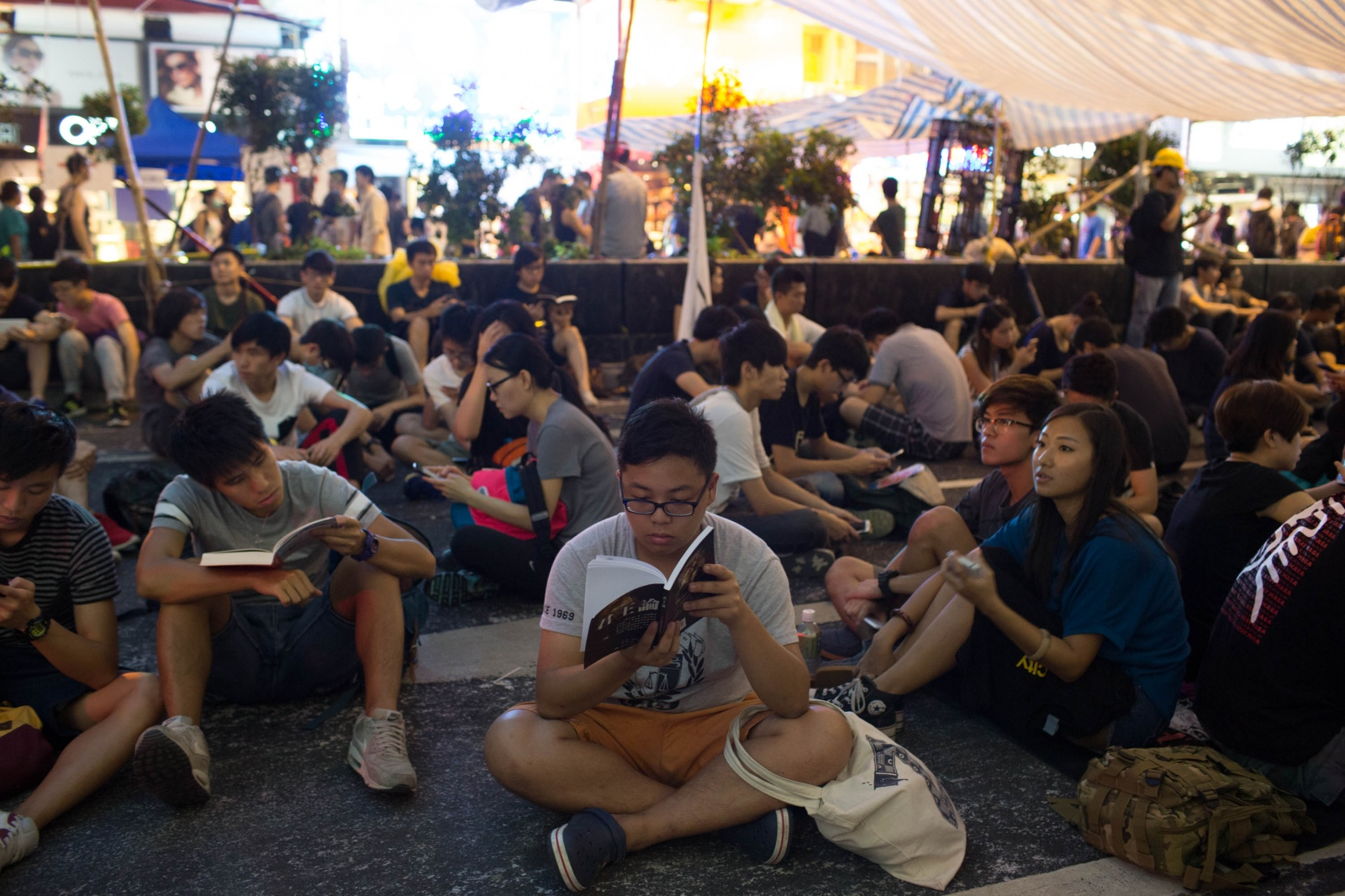 Students gather under makeshift tents to study and read during a protest sit in, in Mong Kok, Hong Kong, on October 4, 2014.