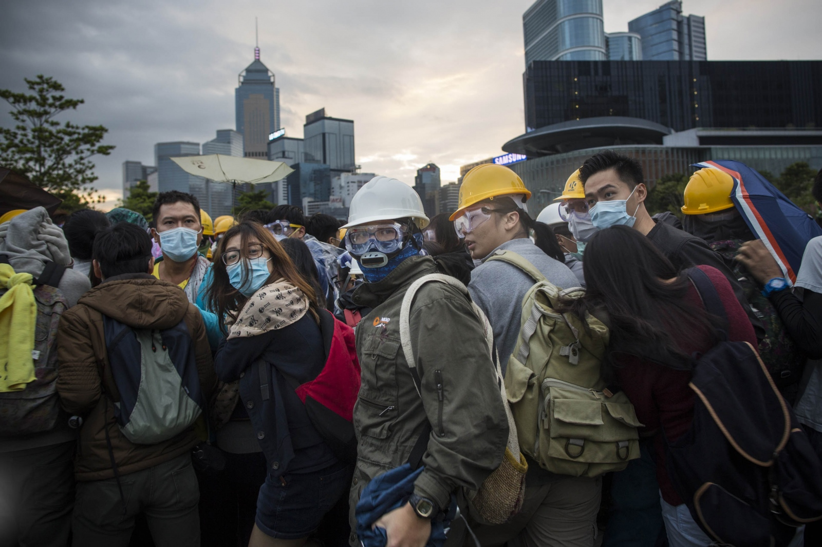 Protesters look back at approaching police, following a violent night of scuffles with them in the Admiralty district of Hong Kong, in the early hours of December 1, 2014. Protesters attempted to retake and occupy a major road that had earlier been cleared by the police weeks earlier.