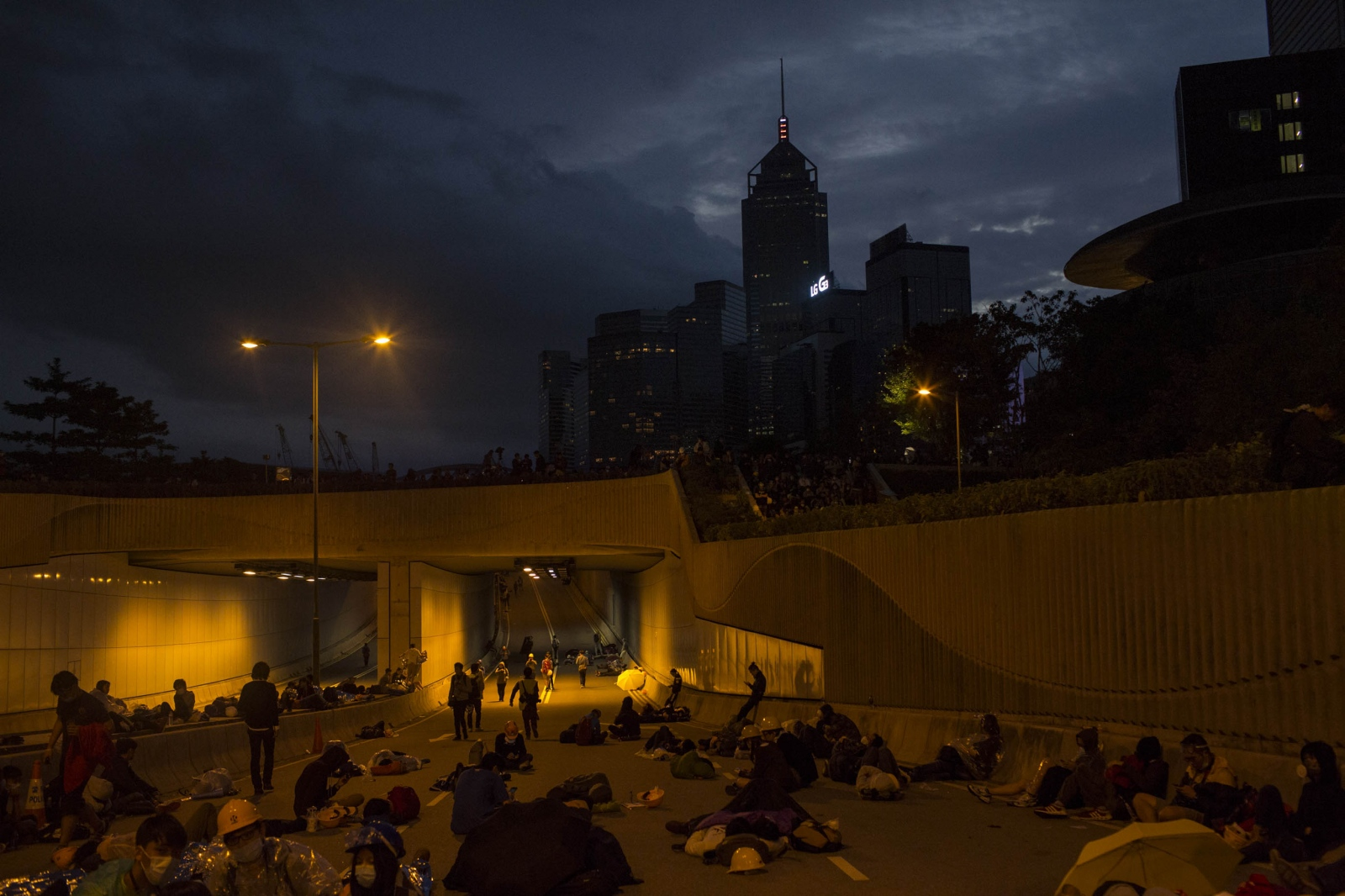 Protestors catch whatever sleep they can get during a violent night of scuffles with the police in the Admiralty district of Hong Kong, in the early hours of December 1, 2014. Protestors attempted to retake and occupy a major road that had earlier been cleared by the police weeks earlier.