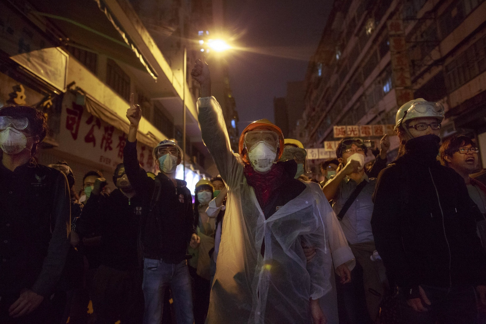 Protesters chant slogans calling for universal suffrage, during a night of confrontation with the police in the Mong Kok district of Hong Kong, on November 25, 2014.