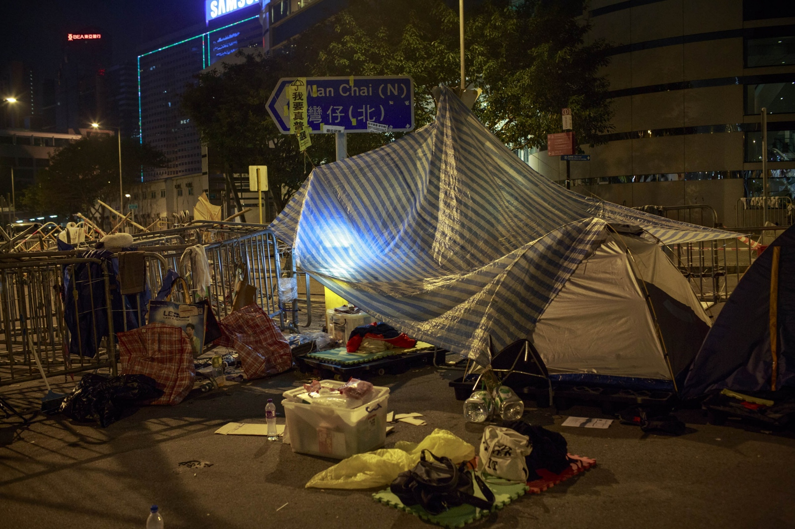 A tarp and tents are seen in one section of the main protest site in the Admiralty district of Hong Kong, on November 16, 2014. For weeks, protesters remained camped out in the heart of Hong Kong, sleeping in tents and staging peaceful demonstrations, whilst blocking major thoroughfares and roads of the city for just over two months, calling for universal suffrage in 2017 with the right to elect the city's own chief executive-- without Beijing's pre-approval of candidates-- a demand that remains rejected by Beijing.