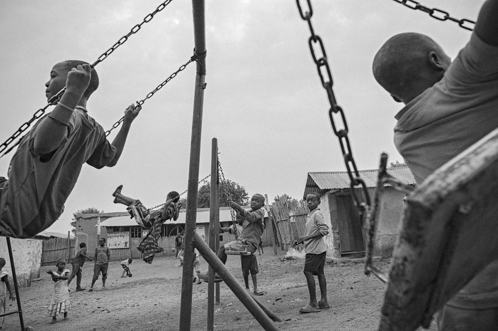 Children play on a swing set in UPDECO's reintegration center in Rutshuru, Eastern DRC, on Monday, July 21, 2014. Poverty and a cycle of violence in the decades long conflict makes children susceptible to being forcibly recruited by the myriad militia groups operating in the east of the country.