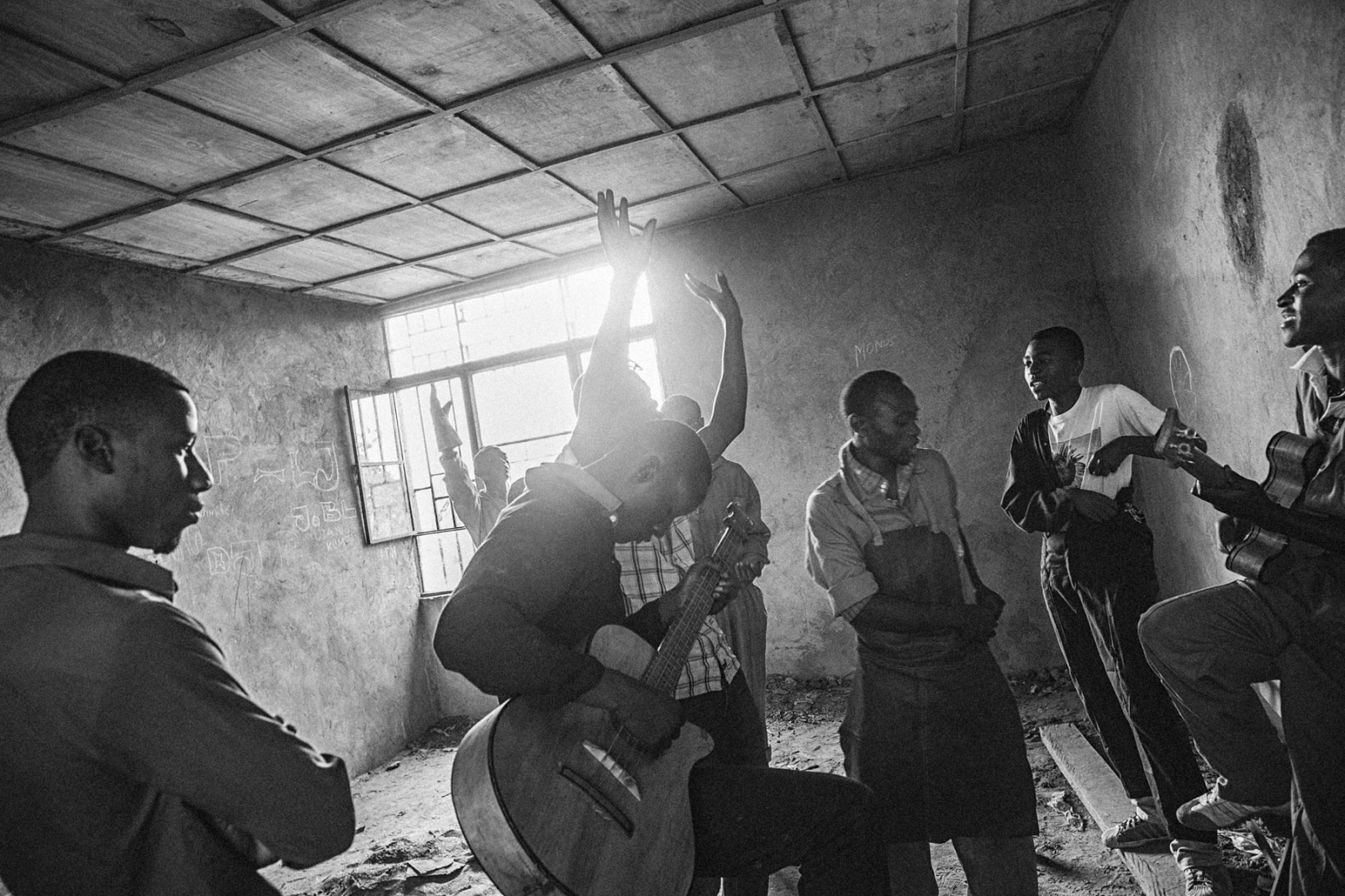 Young men and boys play an impromptu session of music, singing in an unfinished room as a part of their masonry project at the ETN Center in Goma, Eastern Democratic Republic of Congo, on Friday, July 18, 2014. The ETN Center, funded partly by UNICEF, MONUSCO and also supported by Finnish Church Aid, is one of the few training centers where former child soldiers and street kids are given an opportunity to learn a skill that can then get them jobs. The skills they can acquire can allow them to become masons, carpenters, mechanics, hairdressers, or tailors. They also learn how to cook and have recreational activities at the center, and accept young adults from 16-22 years of age.