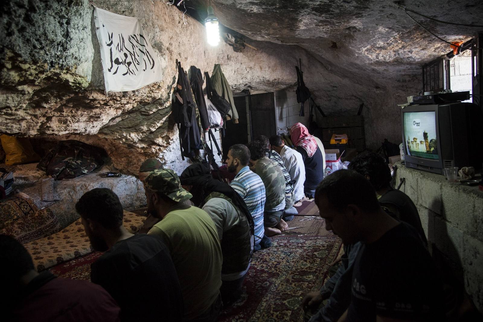 Free Syrian Army fighters pray in a cave in the mountains outside of Sarmadda, a town near the Syrian border, on Thursday, June 7, 2012. The FSA are often ill equipped to fight against tanks, Grad rockets and mortars used by the Syrian Army.