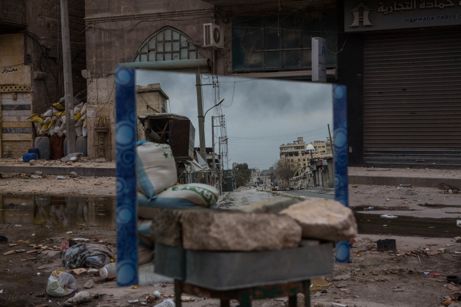 A mirror, reflecting a street and a building where government snipers are in hiding, balances on a stool in the Old City of Aleppo, Syria, on March 19, 2013.