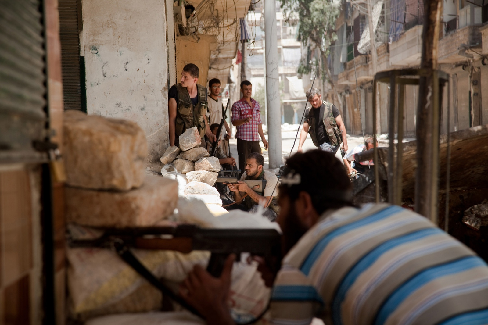 Fighters from the Free Syrian Army, who are a part of the Tawhid Brigade, attempt to fire on Syrian Army positions on the front lines in the Salaheddin neighborhood of Aleppo, Syria, on Wednesday, August 1, 2012. Fierce fighting erupted in Aleppo, Syria's commercial capital and its most populated city, one and a half weeks ago as FSA fighters poured in to the city with weapons to fight against the Syrian Army. Many of the battles have taken place in restive neighborhoods such as Salaheddin, which saw the biggest anti-government protests throughout the revolution. Almost all of the estimated 200,000 residents have fled to other areas of Aleppo for safety, and many men have stayed to fight alongside the FSA.
