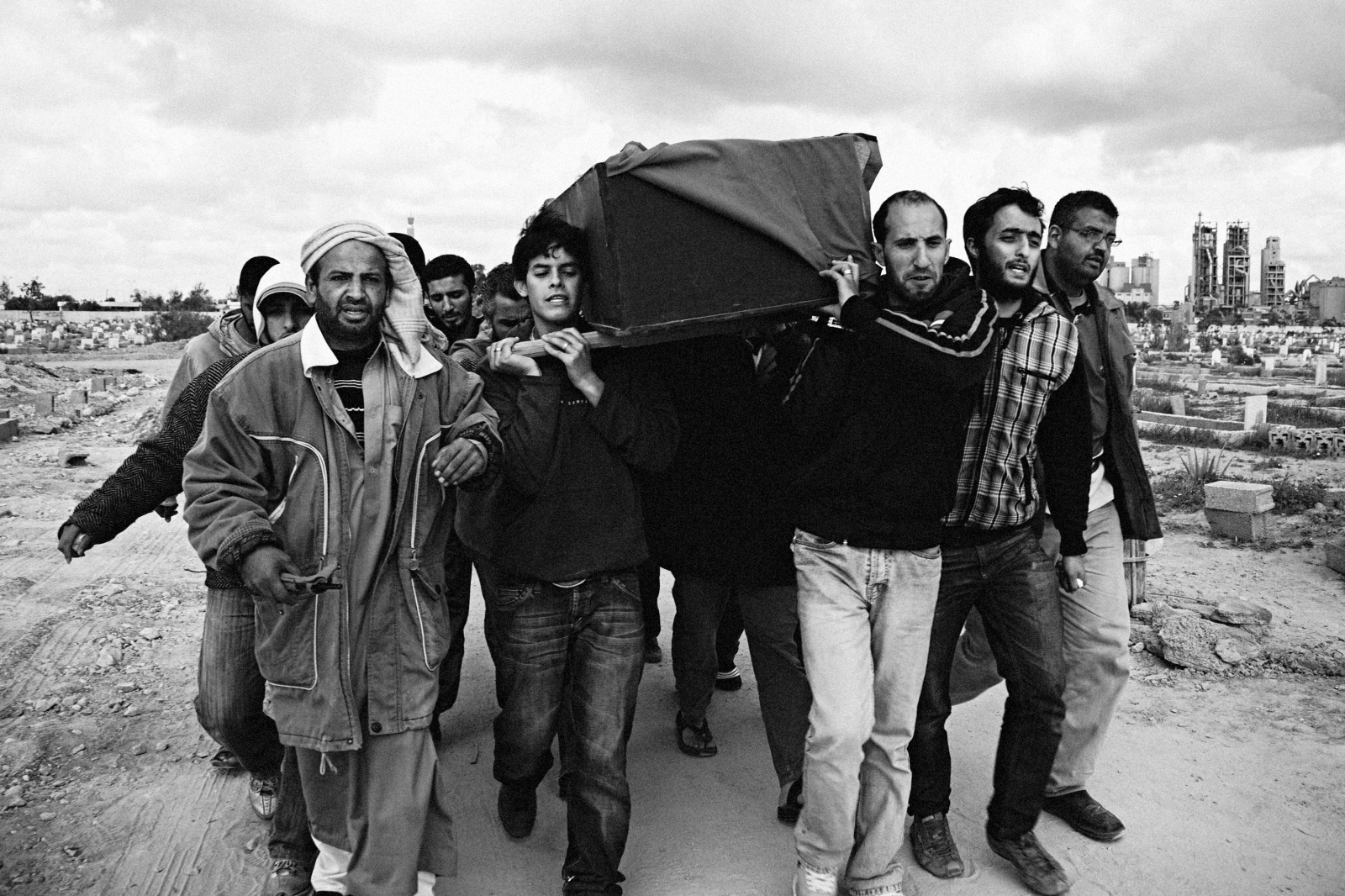 Family and friends of slain cartoonist and journalist Qais el-Haldy carry his coffin for burial in Benghazi, Eastern Libya on March 21, 2011.