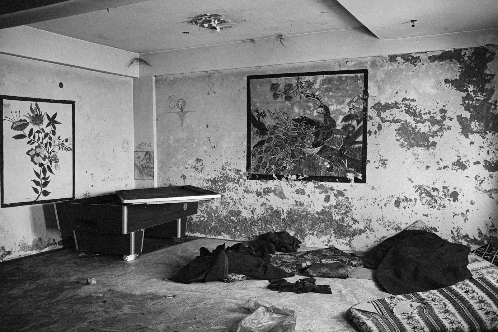 A room used by Gaddafi soldiers is seen littered with their clothing and food wrappers at a police station in Benghazi, Libya, on March 5, 2011.