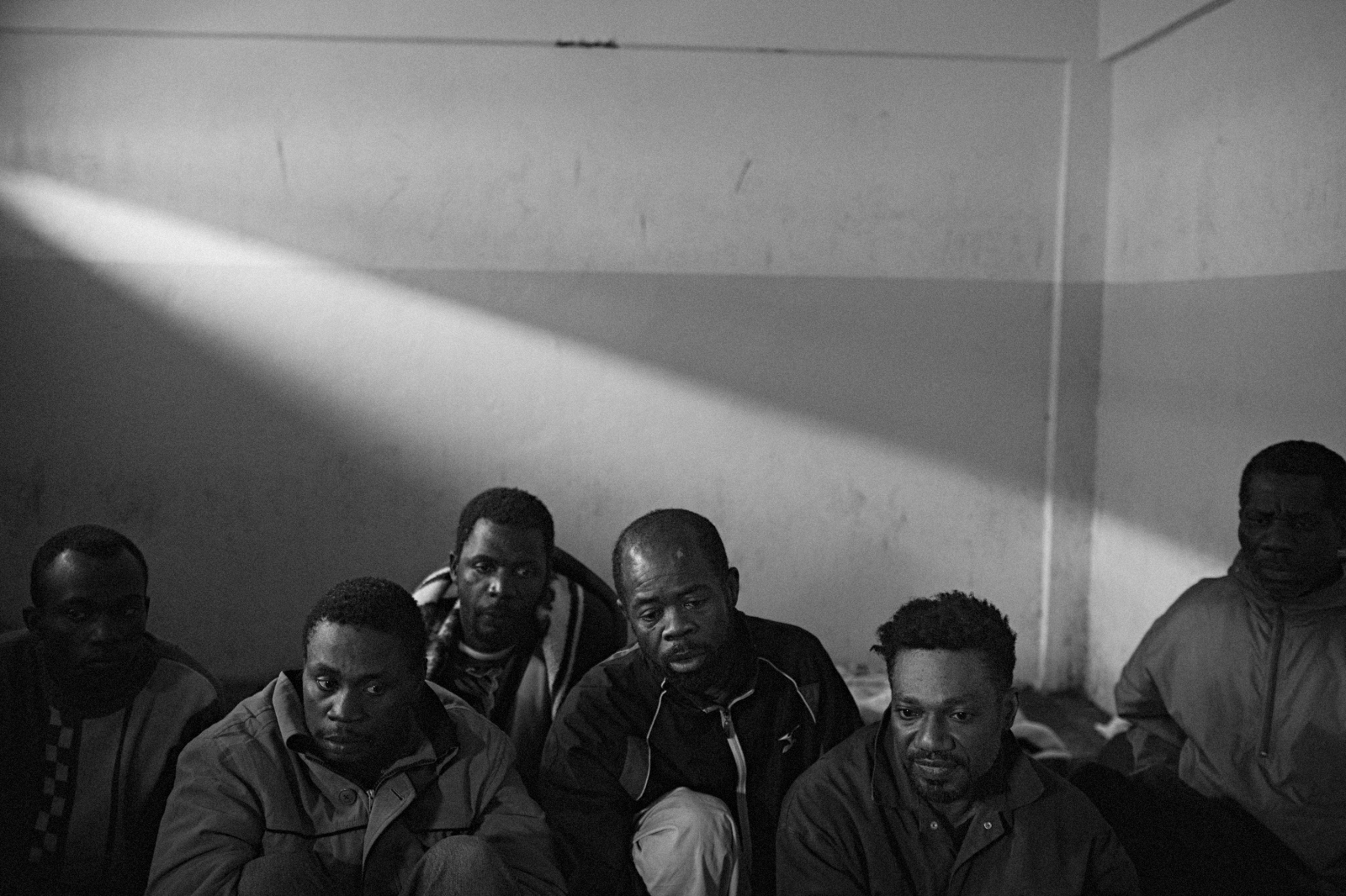 Suspected mercenaries are held in a prison cell at the courthouse in Benghazi. Most turned out to be innocent migrant workers caught up in the revolution, suspected of being hired by Ghaddafi to kill protesters. February 25, 2011, Benghazi, Libya.
