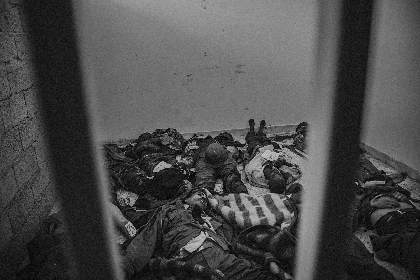 Bodies of Gaddafi's soldiers lay in a makeshift cell near a hospital in Benghazi, Libya, on March 20, 2011, a day after Western powers including the UK and France began airstrikes on Gaddafi's forces, which threatened to crush the revolution in the east with their speedy march towards Benghazi.