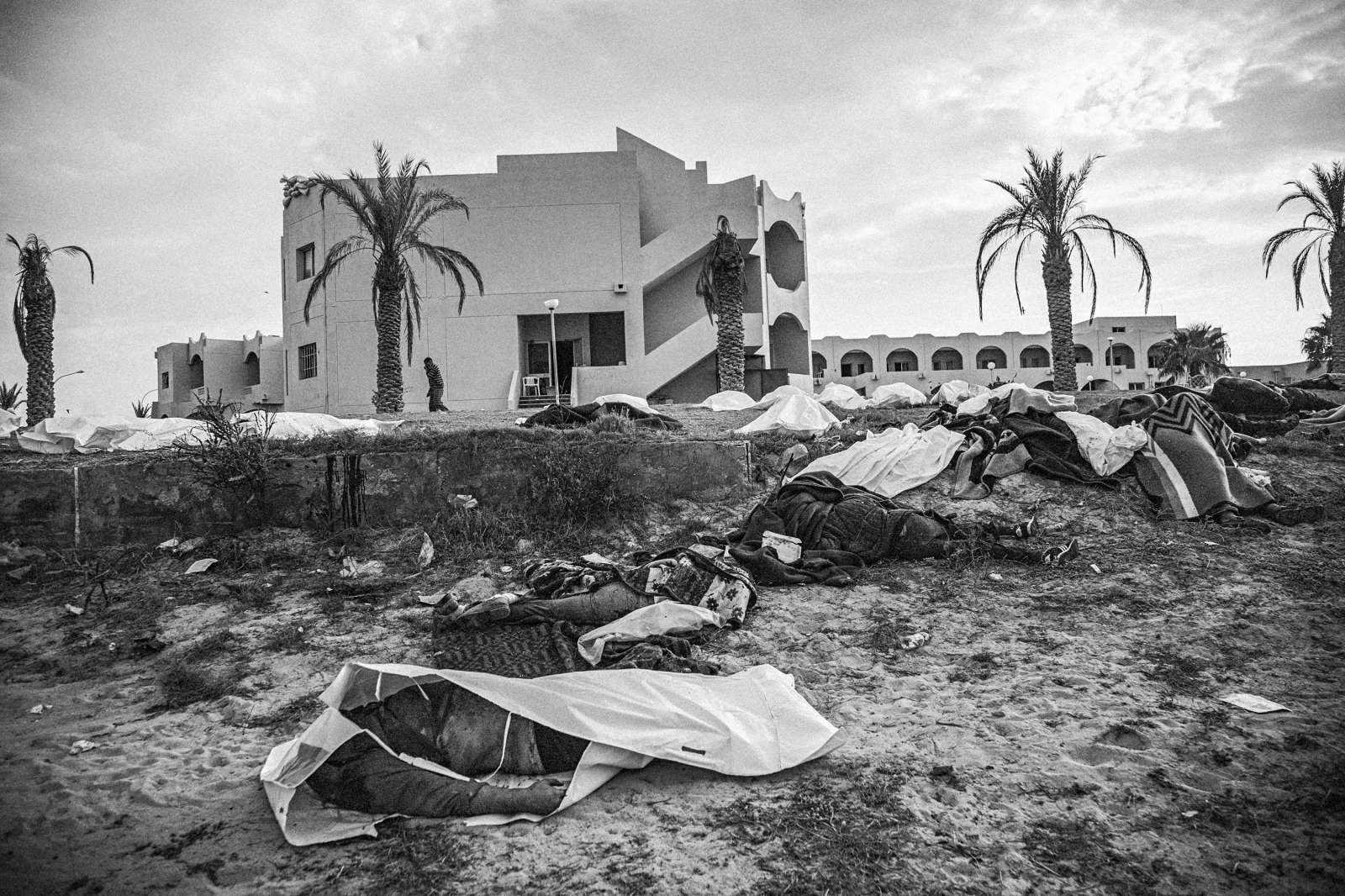 Bodies lay on the front lawn and beach of the Mahari Hotel, where 53 bodies were found following the battle for Sirte, Libya, on October 23, 2011. Most of the bodies had been there for at least several days, some with hands bound behind their backs in an apparent mass execution of supposed Gaddafi loyalists by rebel fighters.