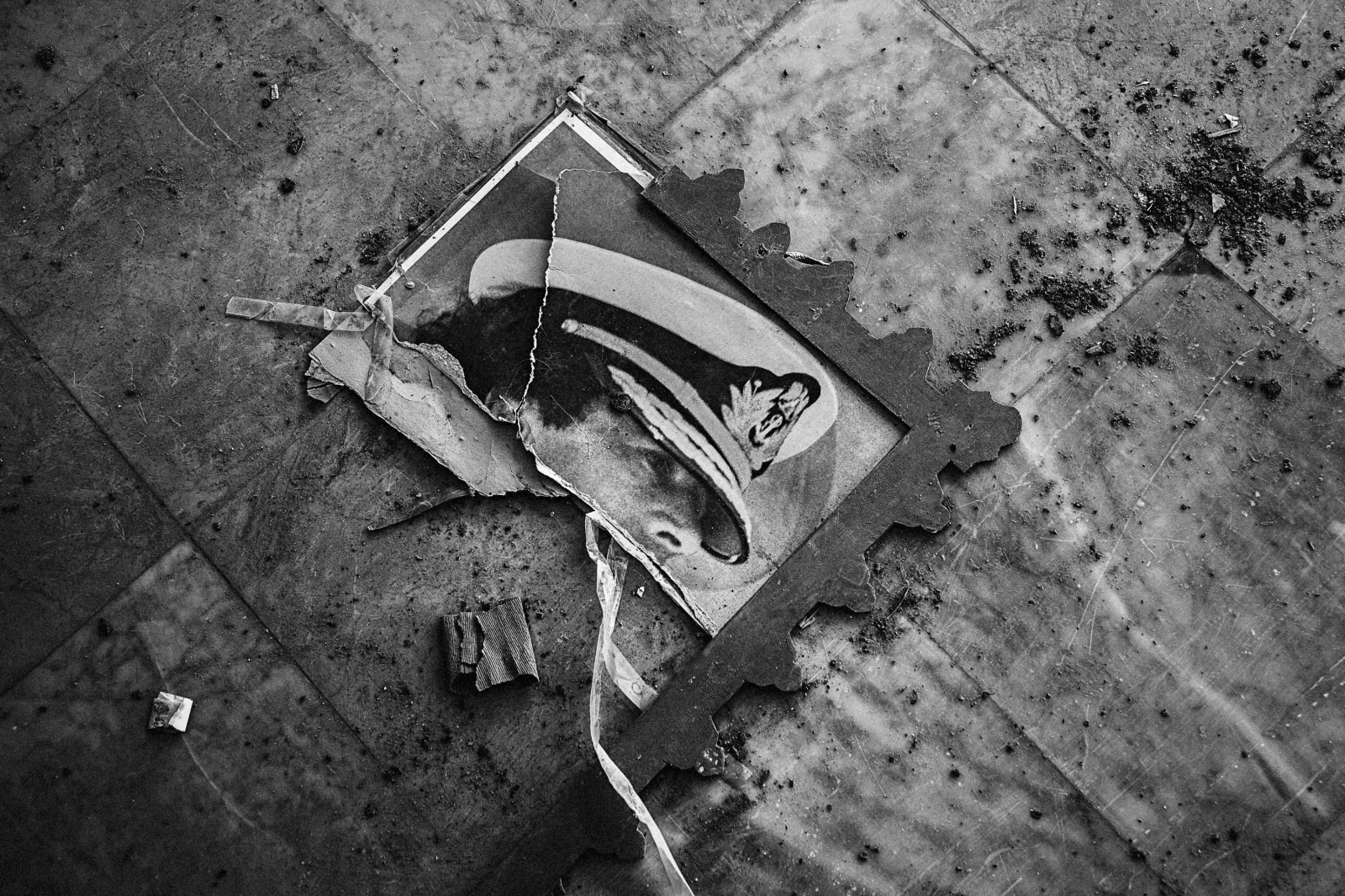 A destroyed poster of Gaddafi lays in ruins on the floor of a school in Towergha, a town east of Misurata, on October 25, 2011. Towergha has been cleared of all its residents accused by the Misuratans of fighting for Gaddafi forces during the siege of Misurata between March and June.