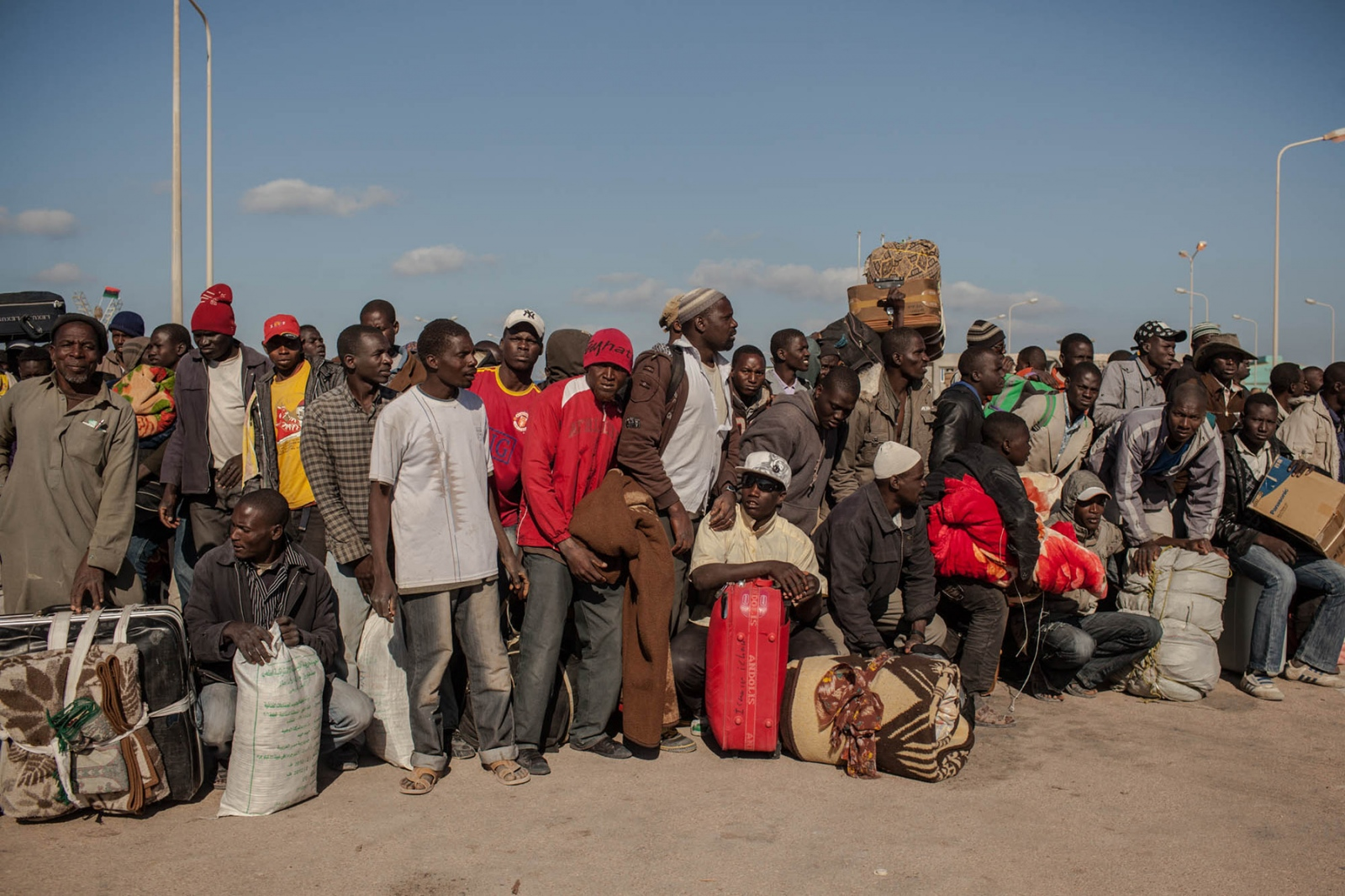 African migrant workers wait to be evacuated from the besieged city of Misurata on April 18, 2011.