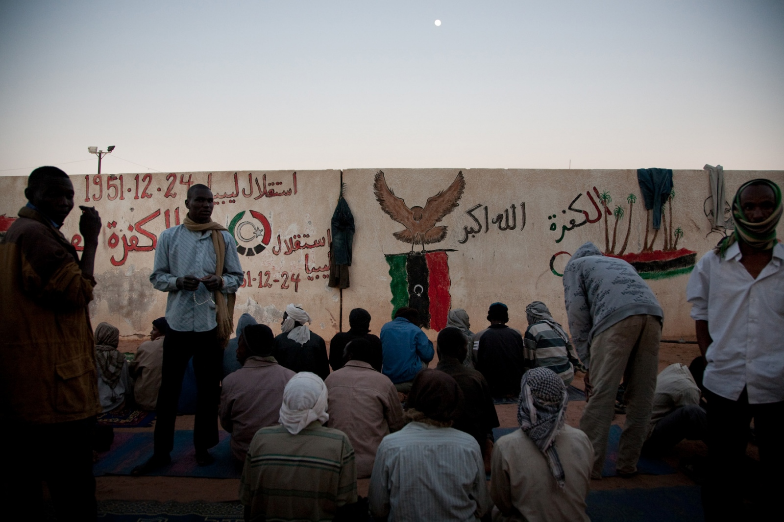 Migrants prepare for evening prayers at the detention facility in Kufra, southern Libya, on March 6, 2012.