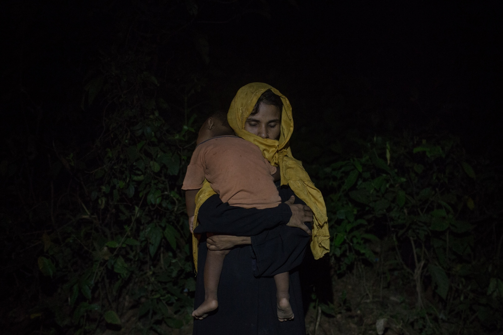 Kulsuma, 30, embraces her son while waiting by the side of the road for food and cash distributions near the Balukhali refugee camp in Bangladesh on Friday September 22, 2017. Kulsuma arrived in Bangladesh 8 days ago. She does not know the fate of her husband.