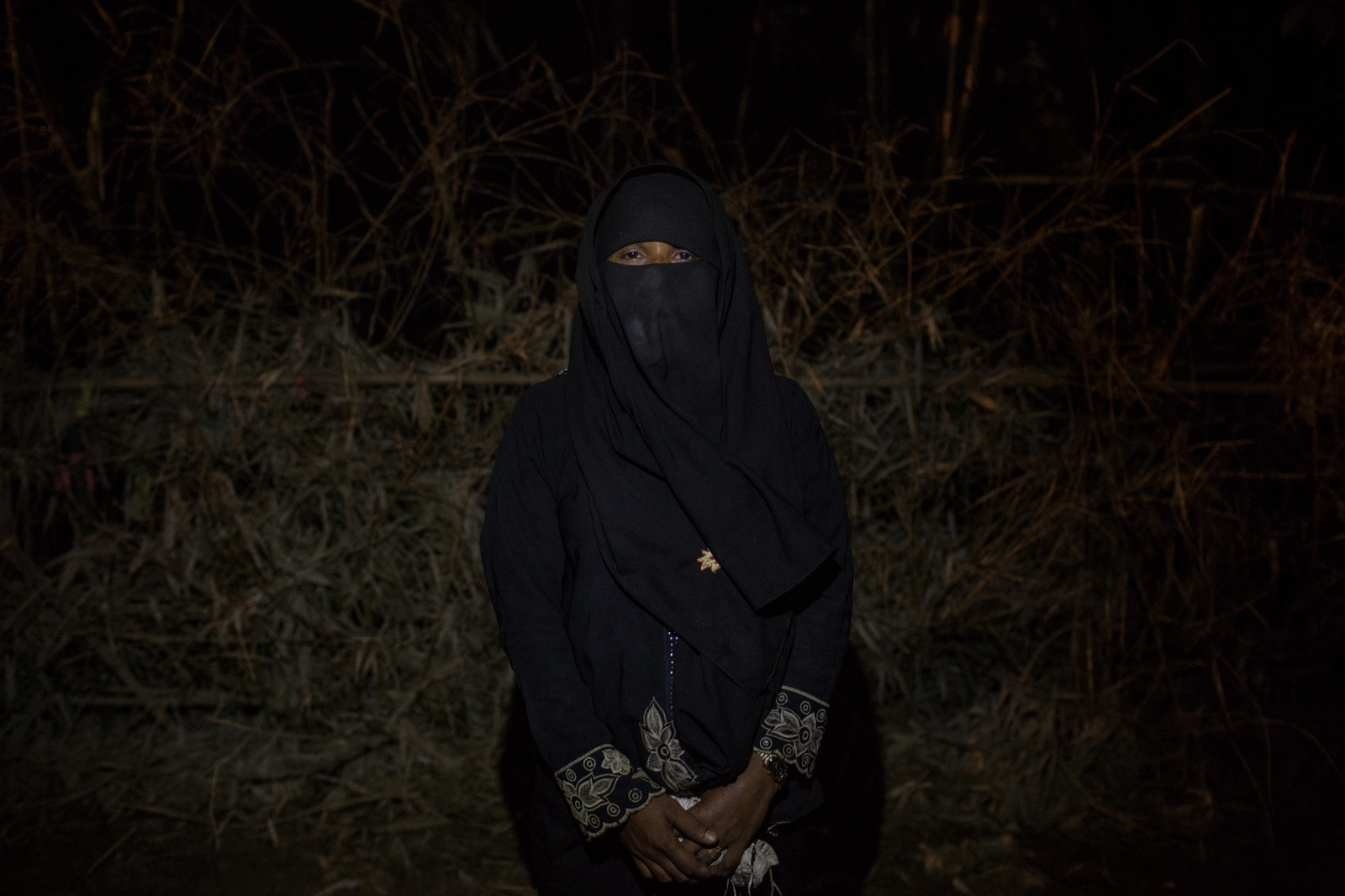 Nulbahar, 20, waits by the side of the road for food and cash distributions near the Balukhali refugee camp in Bangladesh on Friday September 22, 2017. Nulbahar, from the Maungdaw Township in Myanmar fled with her five children after the Burmese Army took her husband out of their house. She does not know what happened to him.