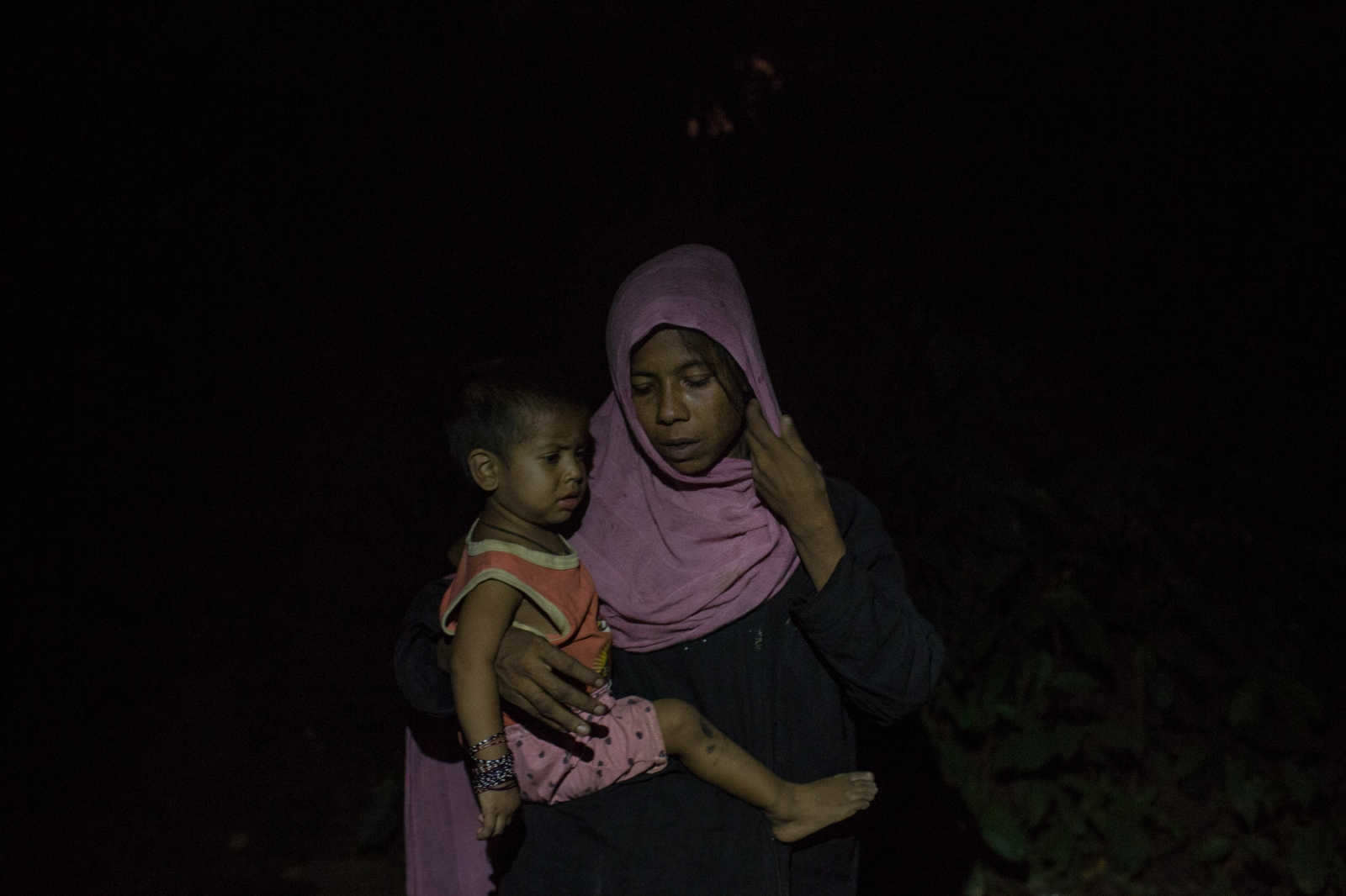 Rogina Begum, 25, waits by the side of the road for food and cash distributions near the Balukhali refugee camp, in Bangladesh on Friday, September 22, 2017. Rogina was widowed two years ago when her husband, a fisherman, died at sea. She was forced to flee when the military began their assault on her village.
