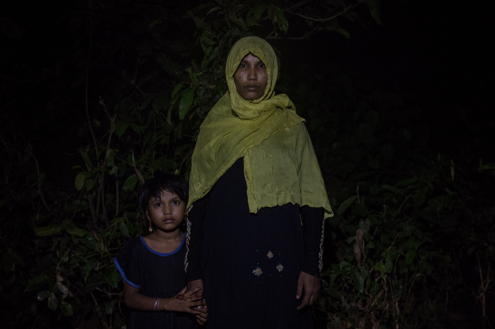 Shuma Maher, 35, waits with her daughter by the side of the road for food and cash distributions near the Balukhali refugee camp in Bangladesh on Friday September 22, 2017. Shuma's husband remains in Myanmar but she does not know if he is alive. They were separated when the military attacked their village.