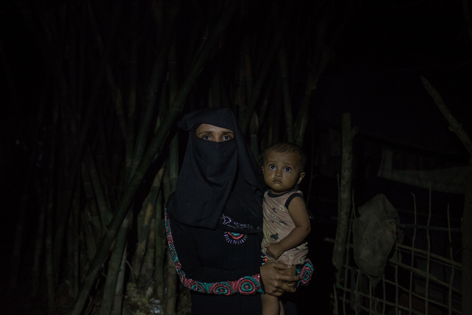 Settera, 30, waits with her baby by the side of the road for food and cash distributions near the Balukhali refugee camp in Bangladesh on Friday September 22, 2017. Her husband was shot and killed by the Burmese Army and her house burned when they entered her village in the Maungdaw.