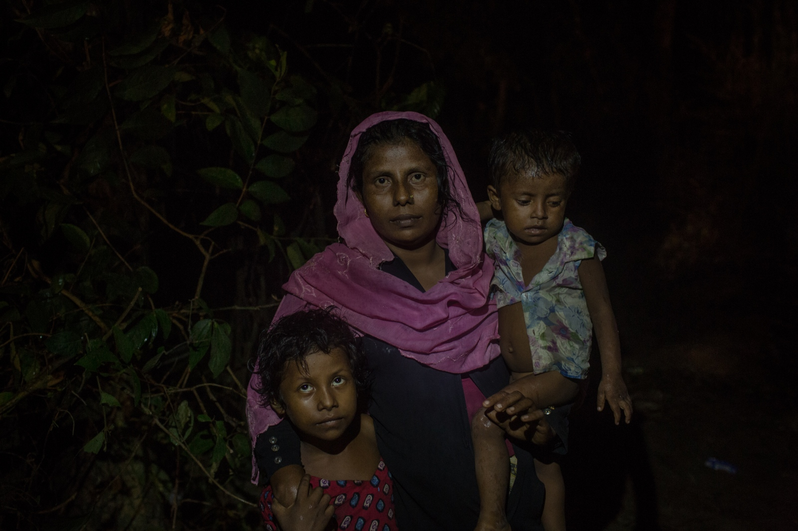 Jahan, 25, waits with her two children by the side of the road for food and cash distributions near the Balukhali refugee camp in Bangladesh on Friday September 22, 2017. Jahan's husband remains in Myanmar but she does not know of his fate. The Burmese Army attacked their village, attempting to round up its civilians, when her husband ran away.