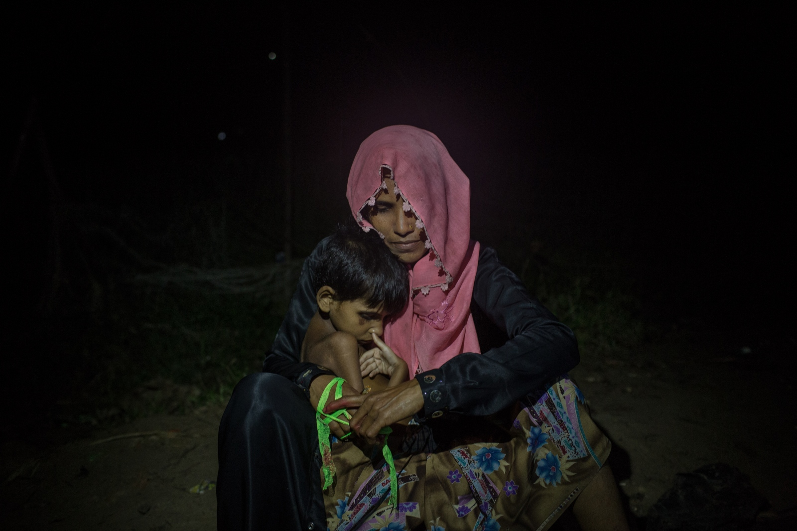 Hasina Begum, 25, waits with her son by the side of the road for food and cash distributions near the Balukhali refugee camp in Bangladesh on Friday September 22, 2017. Hasina does not know where her husband is as they were separated after crossing the border in to Bangladesh.