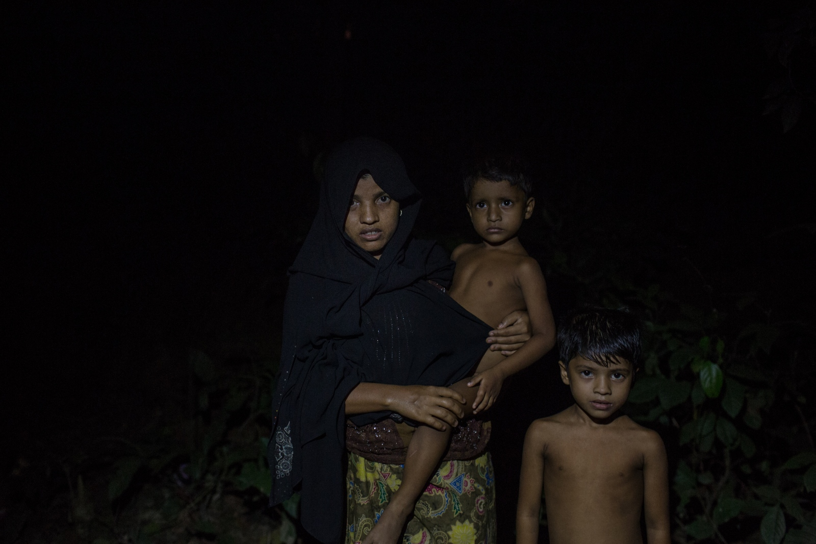 Alkama, 20, waits with her two children by the side of the road for food and cash distributions near the Balukhali refugee camp in Bangladesh on Friday September 22, 2017. When the Burmese Army entered her village, they attempted to flee but were caught. Soldiers then killed her husband before releasing Alkama and her children.