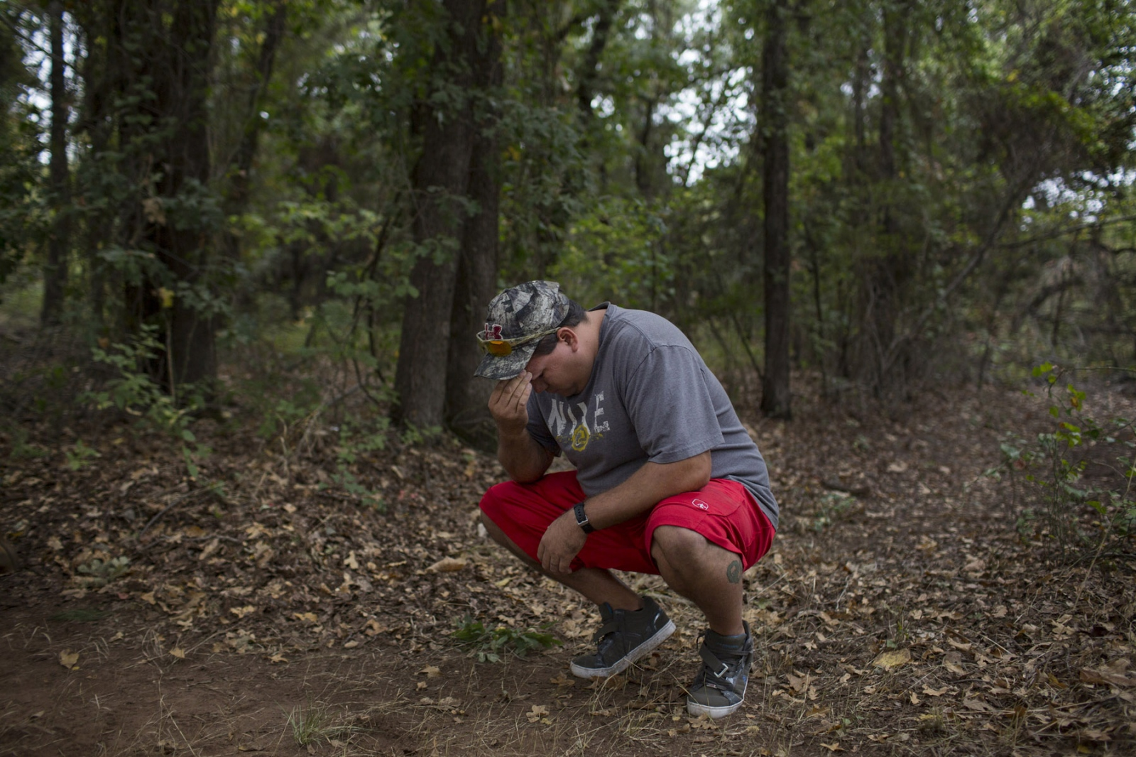 Specialist Michael Sankadota pauses and winces during an intense migraine during the building of a teepee near Anadarko, Oklahoma. 2014. Physical activity often brings on intense migraines for Specialist Sankadota, 30, with the migraines being rated from 1-10. Mr. Sankadota was deemed 100% disabled by the Veterans Affairs as a result of the traumatic brain injuries he has sustained whilst on tour in Iraq.