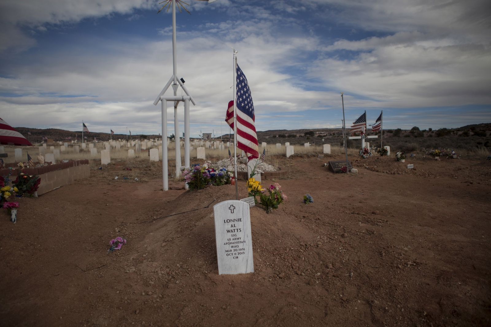 "The grave of Staff Sergeant Lonnie A. Watts of the 82nd Airborne Division is seen at the Veterans Cemetery in Fort Defiance, Arizona. 2014. SSG Watts served in both Afghanistan and Iraq but never sought counseling for PTSD because it was something ""[he] was not proud of,"" according to his wife Latonya Johnson."