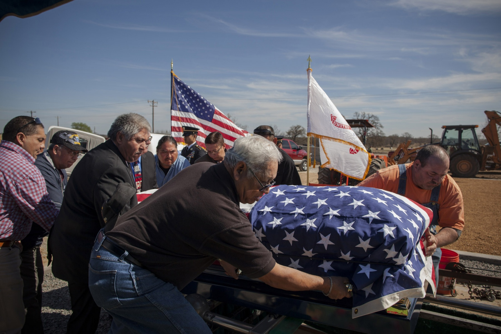 Friends and relatives carry the casket containing the body of Edmond A. Harjo during funeral services on Friday, April 4, 2014 in Seminole, Oklahoma. Mr. Harjo was a Seminole Code Talker who served in Europe during World War II as a Private First Class and returned to the US after active duty in 1944 and remained in Maud, a nearby town, until his death at 96 on Monday, March 31, 2014. He was awarded the Congressional Gold Medal in 2013 for his efforts in using his language during the war. He was buried in the new veterans memorial grounds on the Seminole Nation and was given a small military funeral.