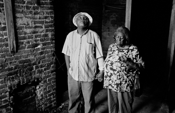 """One year after hurricane Katrina Steve and Julia Stewart inspect their house outside with tears in their eyes. Steve in Korean War veteran and sister Julia, a retired school teacher. Julia says, """" We are not looking for a handout, we are just looking for a hand up. This is the first time in my life I will have to pay rent. I was a school teacher for 42 years and did not expect to spend my whole life savings on trying to survive, it's a shame that America could not be able to do better for its people."""" New Orleans, 9.06"""