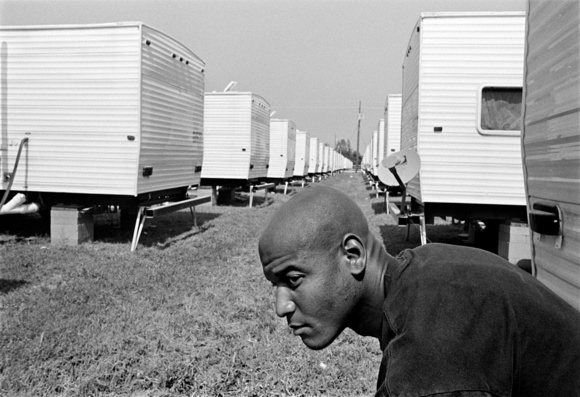 Joel Ware a youth advocate for Youth Empowerment Project sits outside his FEMA trailer. Joel is himself who is an ex-felon who has turned his life around. One year after hurricane Katrina many of the youth are coming back to very little in New Orleans which is creating a lot of anger and frustration with many of the youth and their families. New Orleans. 10.06