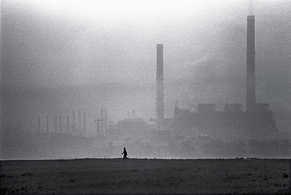 Piatra Neamt, Moldova, Romania. One of the poorest regions of Romania, a worker walks home from a chemical plant.