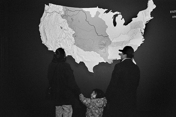 Baltazar Cortes, his wife and child visit the Museum of Westward Expansion, St. Louis. The museum preserves the historical signifigance of the Mexican Migrant workers role in the US. The museum explores the world of the 19th century pioneers who helped shape the history of the American West. Baltazar's dream is to build a life for his family here in the US. St. Louis, MO. 02.97