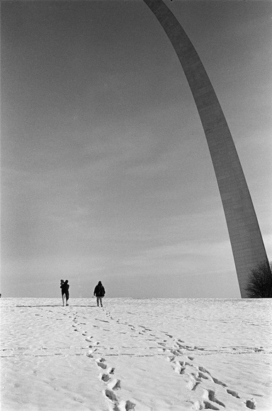 Mexican migrants who have just arrived to St. Louis visit the Museum of Westward Expansion. The Arch is known as the gateway to the west. The Arch, designed by Finnish-American architect Eero Saarinen. St. Louis, MO. 02.97