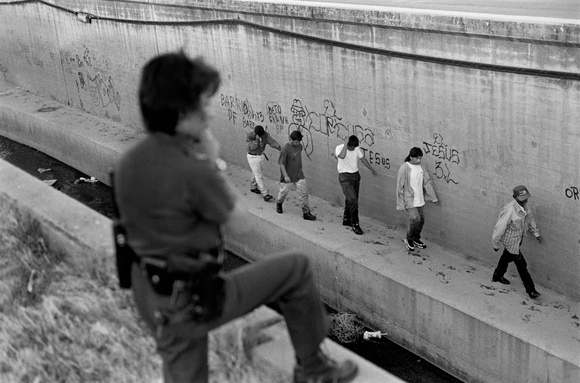 Mexicans return back to Mexico after working in the US. It used to be common for Mexicans to enter the US just for day work. Nogales, AZ. 05.97