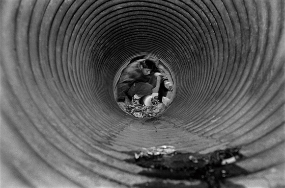 Tunnel kids are homeless kids that live in the tunnels. Narco traffickers often use these young kids to bring large amounts drugs through the border. Nogales, AZ. 05.95