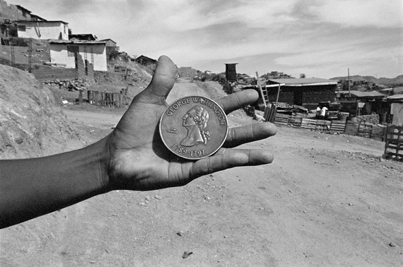 Upon my arrival to Nogales, Sonora, Mexico, I asked a man why he wants to come to the US. In response, he went to his home and brought out this coin. The economic opportunities in the US provide incentive to leave the economically depressed towns in Mexico. Nogales, Sonora, MX. 05.95