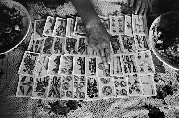 """""""Curandera"""", a woman folk healer, reads the fortune of a man that is about to cross the border to the US. Cheran, Michoacan, Mexico. 07.96"""